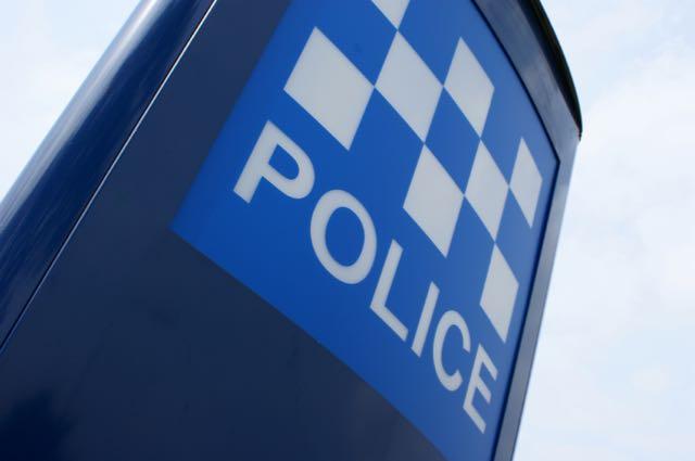 Police Sign closeup LAND.jpg